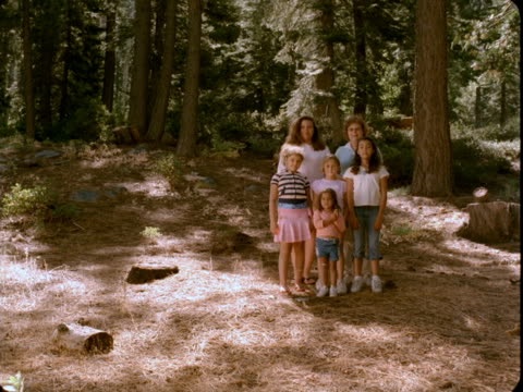 WS, Portrait of female members of three generations family with four girls (4-5, 6-7, 10-11) in woods, Reno, Nevada, USA