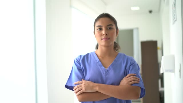 portrait of female nurse at hospital - serious stock videos & royalty-free footage