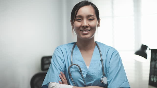 portrait of female nurse at hospital - female nurse stock videos & royalty-free footage