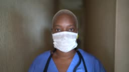 Portrait of female nurse with face mask