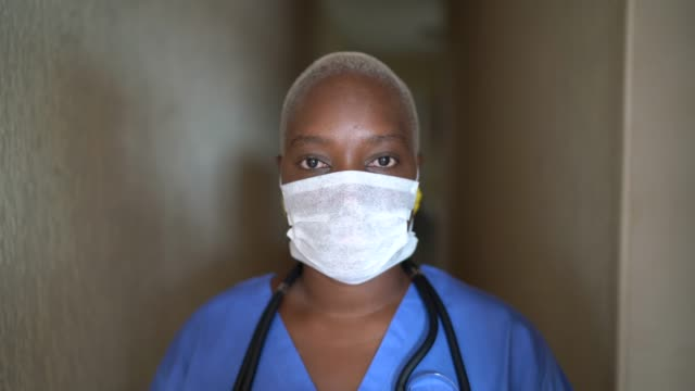 portrait of female nurse with face mask - african ethnicity stock videos & royalty-free footage