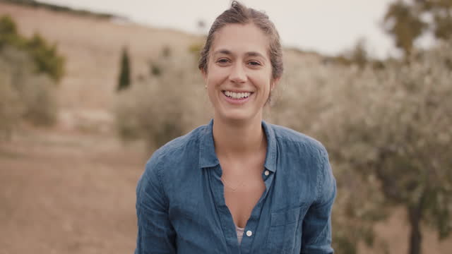 portrait of female olive farmer in orchard - orchard stock videos & royalty-free footage