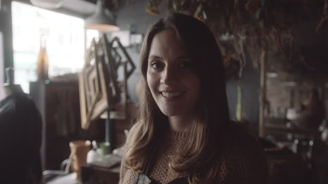 portrait of female retail clerk in vintage craft store - retail occupation stock videos & royalty-free footage