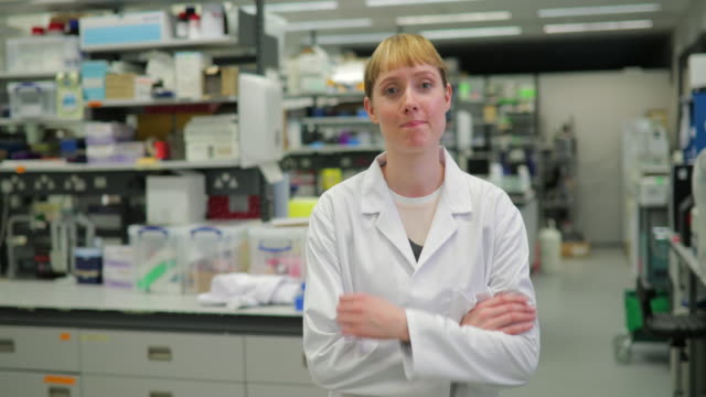 portrait of female scientist in the lab - development stock videos & royalty-free footage