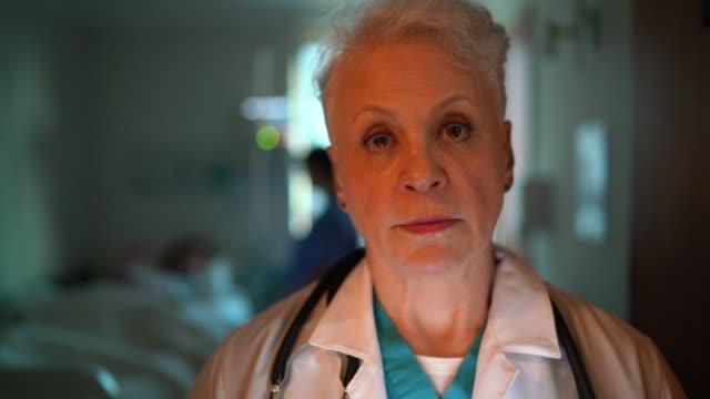 portrait of female senior doctor at hospital room - female nurse stock videos & royalty-free footage