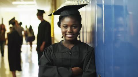 ms zi portrait of female student (16-17) in school corridor / spanish fork city, utah, usa - graduation stock videos & royalty-free footage