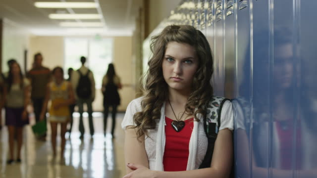 ms zi portrait of female student (14-15) in school corridor / spanish fork city, utah, usa - spind stock-videos und b-roll-filmmaterial