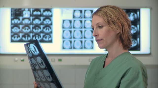 CU, Portrait of female surgeon holding X-rays, Berlin, Germany