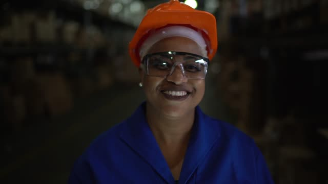 portrait of female worker in warehouse - work helmet stock videos & royalty-free footage