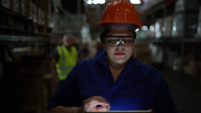 portrait of female worker using digital tablet in warehouse - stereotypical stock videos & royalty-free footage
