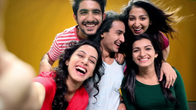 portrait of five friends enjoying - yellow background stock videos and b-roll footage