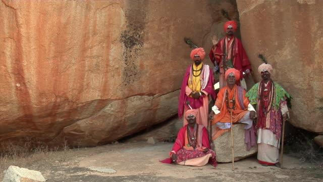 WS, Portrait of five Sadhus at rock, Hampi, Karnataka, India