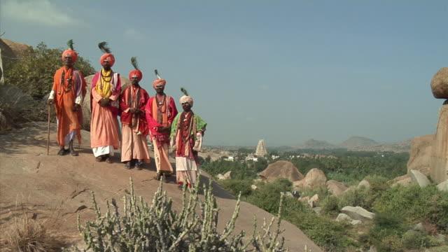 WS, Portrait of five Sadhus standing on hill, Hampi, Karnataka, India