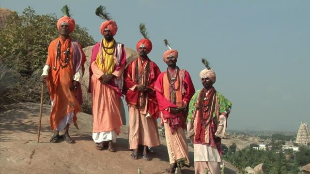 ZO, WS, Portrait of five Sadhus standing on hill, Hampi, Karnataka, India
