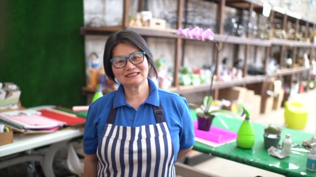 portrait of florist small business flower shop owner - assistant stock videos & royalty-free footage