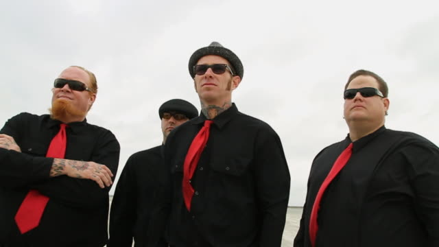 slo mo ms portrait of four men wearing black clothes and red ties / jacksonville, florida, usa - schwarzes hemd stock-videos und b-roll-filmmaterial