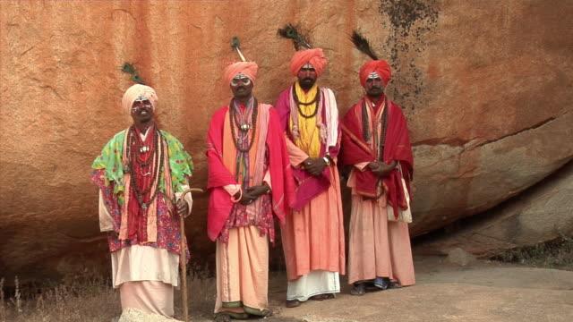 WS, Portrait of four Sadhus standing by rocks, Hampi, Karnataka, India