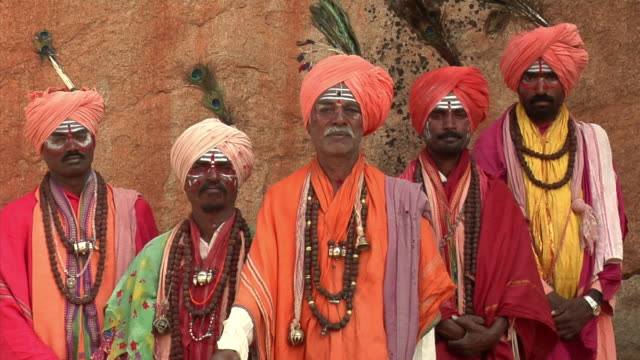 MS, Portrait of four Sadhus standing by rocks, Hampi, Karnataka, India