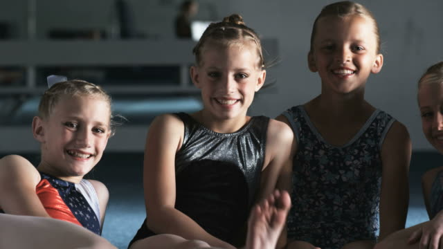 cu pan portrait of four smiling girls (8-9, 10-11) in gym, orem, utah, usa - orem utah stock videos & royalty-free footage