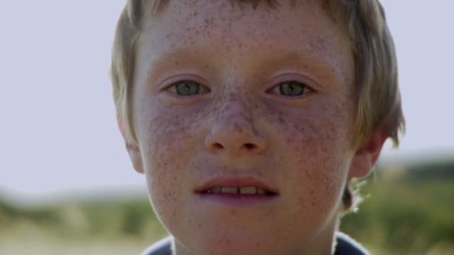 slo mo cu portrait of freckled boy (8-9) looking at camera / hampton, new jersey, usa - freckle stock videos & royalty-free footage