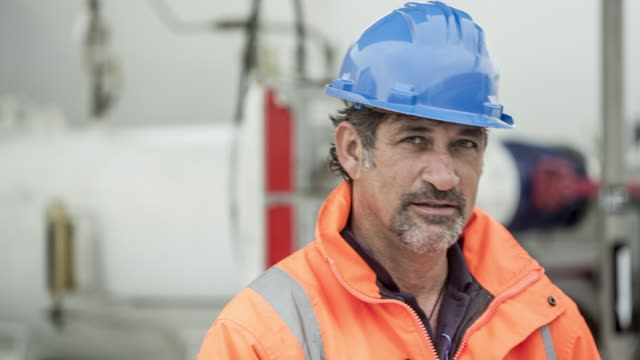 ts cu portrait of fuel depot worker - hard hat stock videos & royalty-free footage