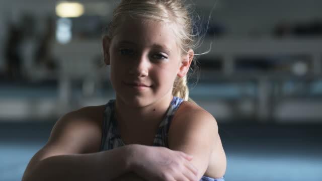 cu portrait of g girl (10-11) sitting in gym, orem, utah, usa - leotard stock videos and b-roll footage