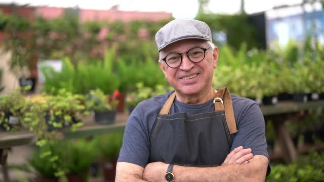 portrait of garden market employee / owner - terza età video stock e b–roll