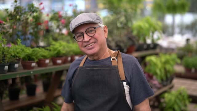 portrait of garden market employee / owner - agricultural fair stock videos and b-roll footage