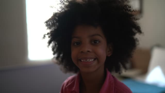 portrait of girl at home - afro stock videos & royalty-free footage