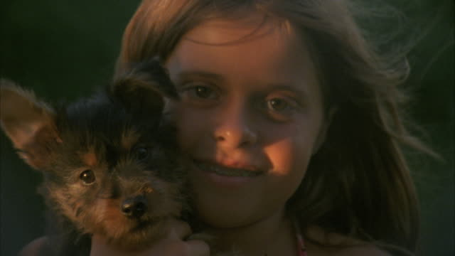 CU, Portrait of girl (12-13) cuddling puppy outdoor, Hortonville, Wisconsin, USA