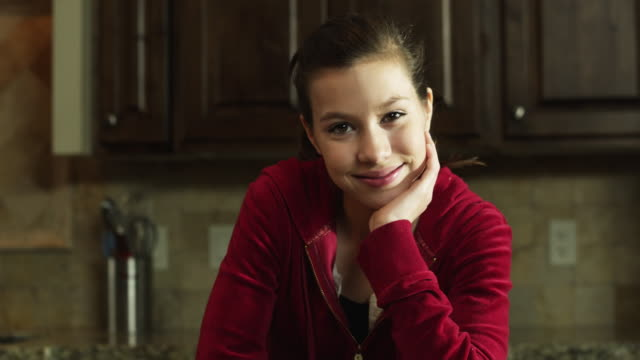 ms tu portrait of girl (8-9) in kitchen / orem, utah, usa - orem utah stock videos and b-roll footage