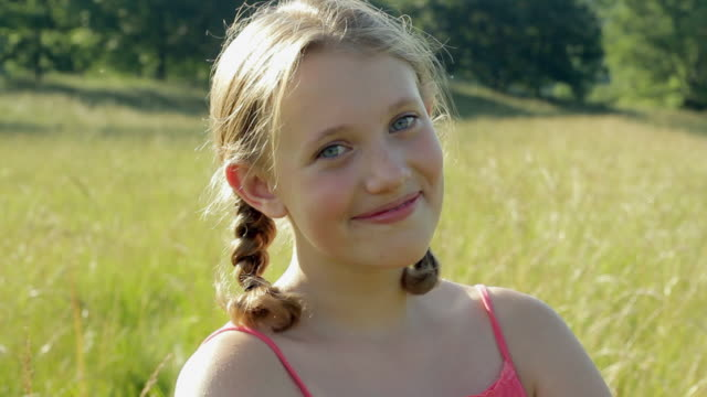 CU Portrait of girl (12-13) in meadow / Glen Gardner, New Jersey, USA