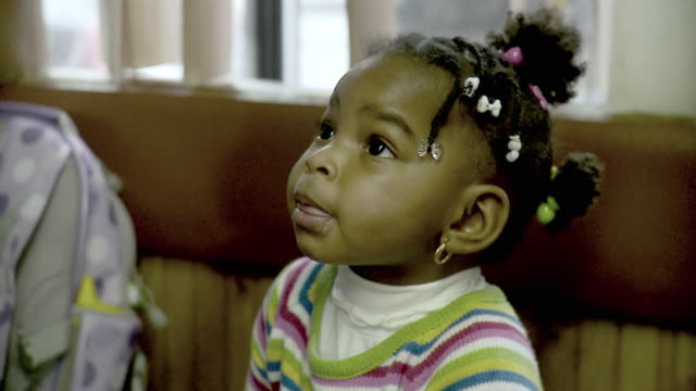 cu portrait of girl ( 18-23 months) looking around sitting at barbershop, brooklyn, new york city, new york state, usa - 18 23 months stock videos & royalty-free footage