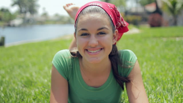 ws portrait of girl (14-15) lying on grass / cape coral, florida, usa - cape coral stock videos & royalty-free footage