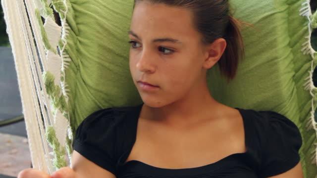 stockvideo's en b-roll-footage met cu portrait of girl (12-13) on swing / buffalo, new york, usa - 12 13 jaar