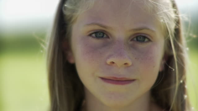 cu portrait of girl (8-9) smiling / hampton, new jersey, usa - only girls stock videos & royalty-free footage