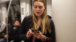 Portrait of   girl   traveling in metro car