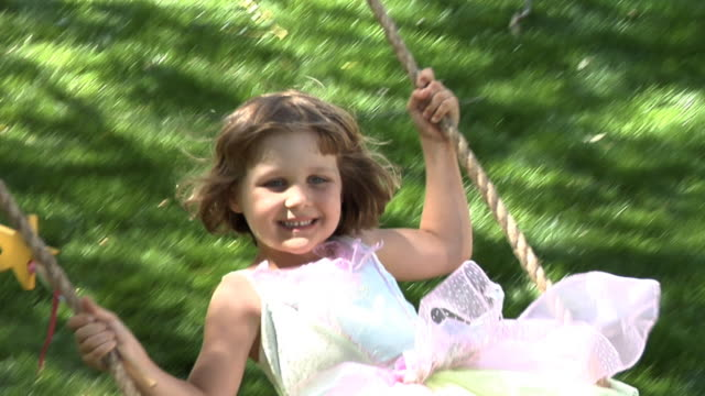cu, portrait of girl (4-5) wearing fairy costume on swing - swing stock videos and b-roll footage