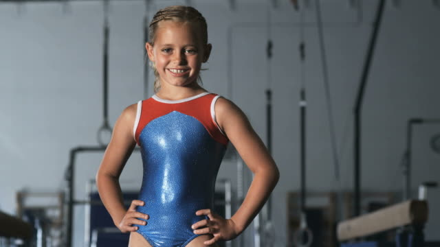 ms tu portrait of girl (8-9) wearing leotard in gym, orem, utah, usa - leotard stock videos & royalty-free footage