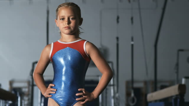 MS TU Portrait of girl (8-9) wearing leotard in gym, Orem, Utah, USA
