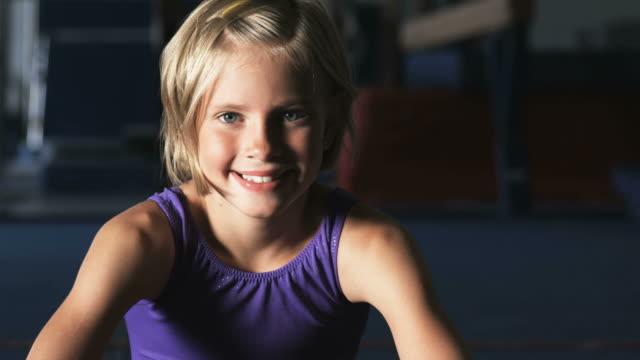 cu portrait of girl (8-9) wearing leotard in gym, orem, utah, usa - leotard stock videos & royalty-free footage