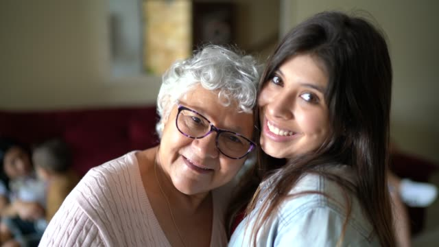 portrait of grandmother and granddaughter at home - granddaughter stock videos & royalty-free footage