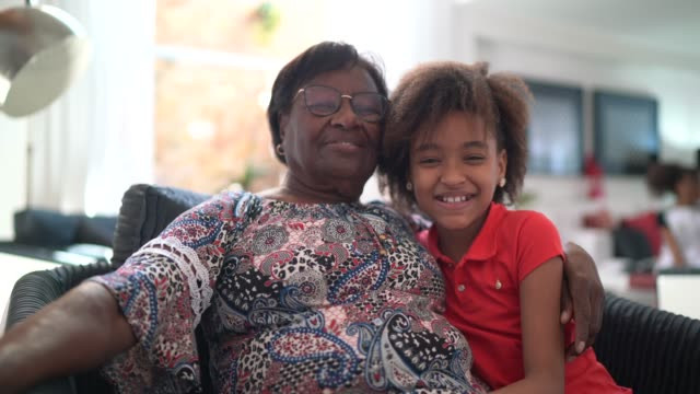 portrait of grandmother and granddaughter at home - grandmother stock videos & royalty-free footage