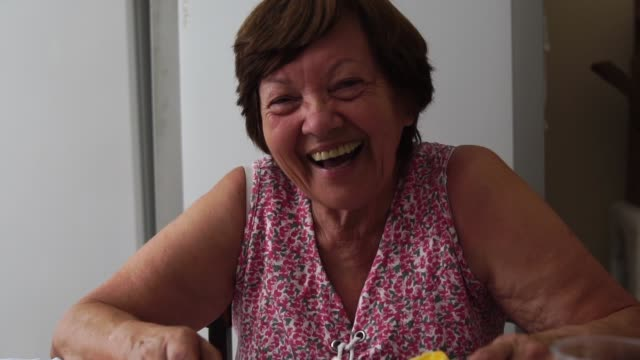 portrait of grandmother smiling - dining room stock videos & royalty-free footage