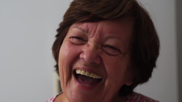 portrait of grandmother smiling - candid stock videos & royalty-free footage