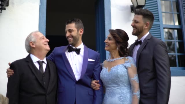 portrait of groom with his happy family before the wedding - christianity stock videos & royalty-free footage