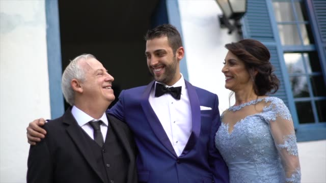 portrait of groom with his parents before the wedding - christianity stock videos & royalty-free footage