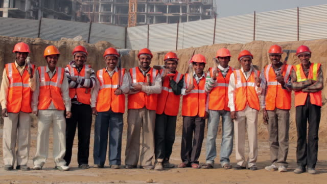 portrait of group of construction workers smiling, delhi, india - lockdown stock videos & royalty-free footage