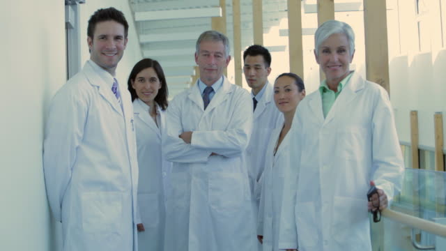 ms pan portrait of group of doctors in hospital hallway / vancouver, british columbia, canada - laboratory coat stock videos & royalty-free footage