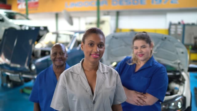 portrait of group of mechanic women in auto repair - gender equality stock videos & royalty-free footage